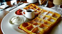Waffles are a house speciality, cooked alfresco on a hot griddle