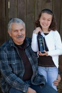 Bob Brakesman with Brian's daughter Sophia Lynn, with her first vintage of Petite Sirah
