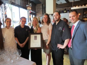 Mill's Tavern earned the 2015 Award of Excellence from Wine Spectator magazine two years in a row. To celebrate, Mill's Tavern held a special party for its loyal guests to sample from its wine collection on Friday, August 7. Posing with the restaurant's 2015 award certificate are: (left to right:) Samantha Del Arroyo, pastry chef; Robin Clark, sous chef; Heather Mitchell, general manager; Shawna Dietz, mixologist; Edward Bolus, executive chef; and Dana Mallard, assistant manager. (Photo courtesy Newberry Public Relations & Marketing Inc.)