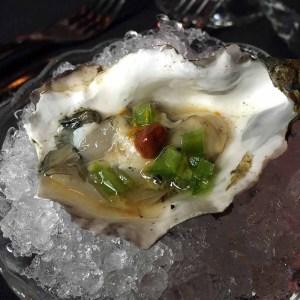 Oyster, lemon, black pepper mignonette and harrissa. | Photo by Steve Coomes