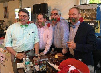Having some fun at the Four Roses booth are Dan Gardner, Aaron Levitch, Jerry Zegart and Brent Elliott. | Photo by Steve Coomes