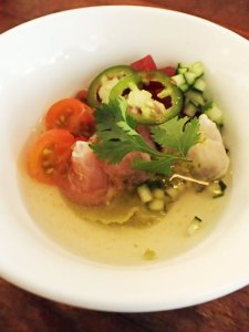 Citrus-cured Kentucky Lake carp with tomatoes and tomato water.   Photo by Steve Coomes