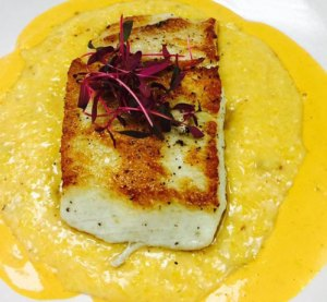 Seared barracuda with bourbon cheese grits with smoked cream. | Photo by David Scales