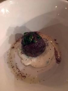 Lamb meatball on tzatziki, sumac and feta.   Photo by Steve Coomes