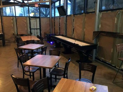Several tables were moved to make room for tabletop and arcade games. | Photo by Steve Coomes