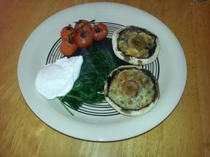 Portabello Mushroom & Cheese with poached egg, vine tomatoes and spinach.