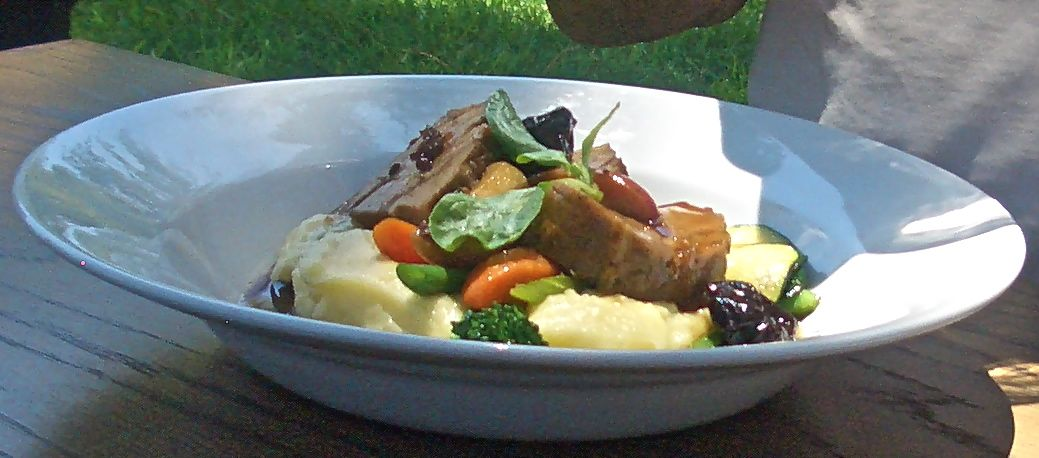 braised pork with apples and prunes olive oil pomme puree and carrots aqua shard subdued lighting