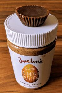 almond butter fat bomb on top of Justin's Almond Butter jar