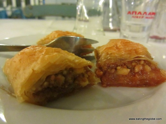 Complimentary baklava with raki at Akrogiali Taverna Restaurant in Crete