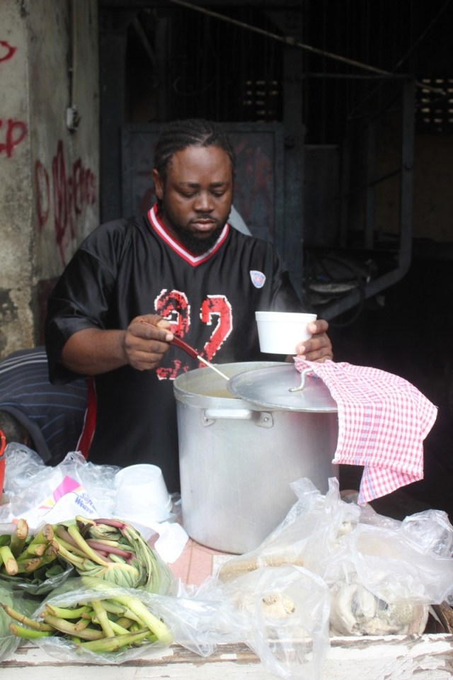 Selling offal soup at the meat market, Grenada