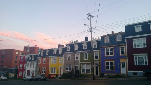 A street of colourful houses in St John's in Newfoundland at dusk