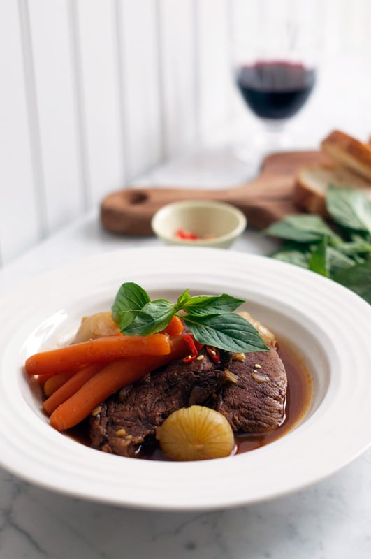 vietnamese beef stew with glass of red wine in background