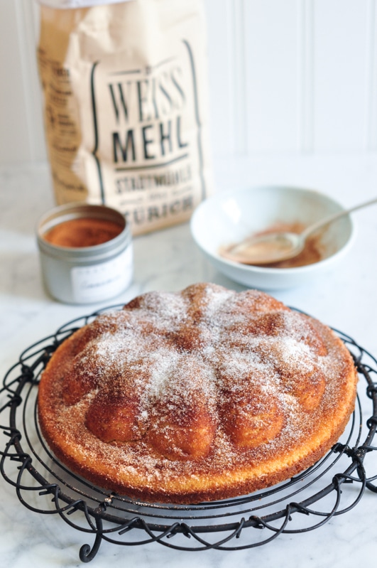 cinnamon tea cake on cooling rack
