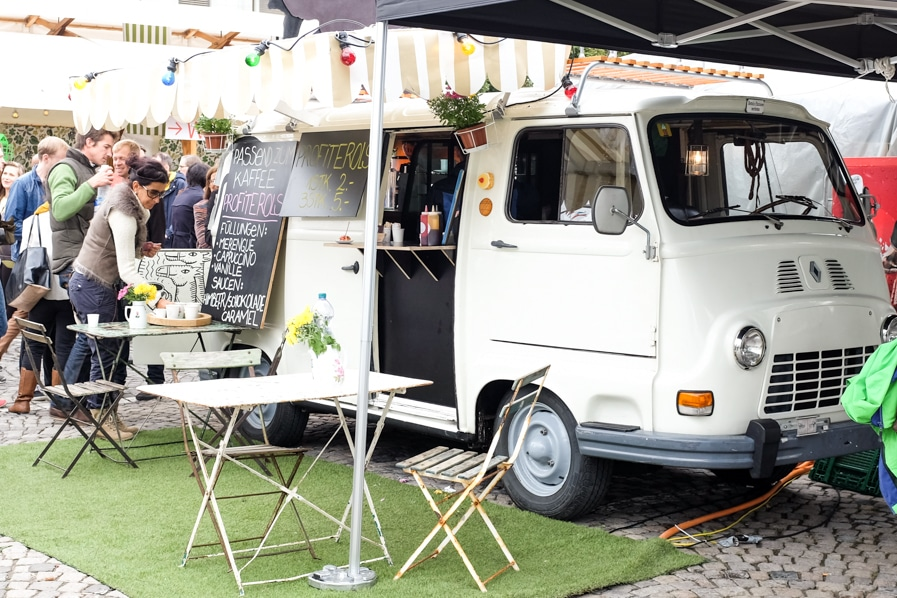 {The Kaffee & Kamele food truck serving coffee with profiteroles.}