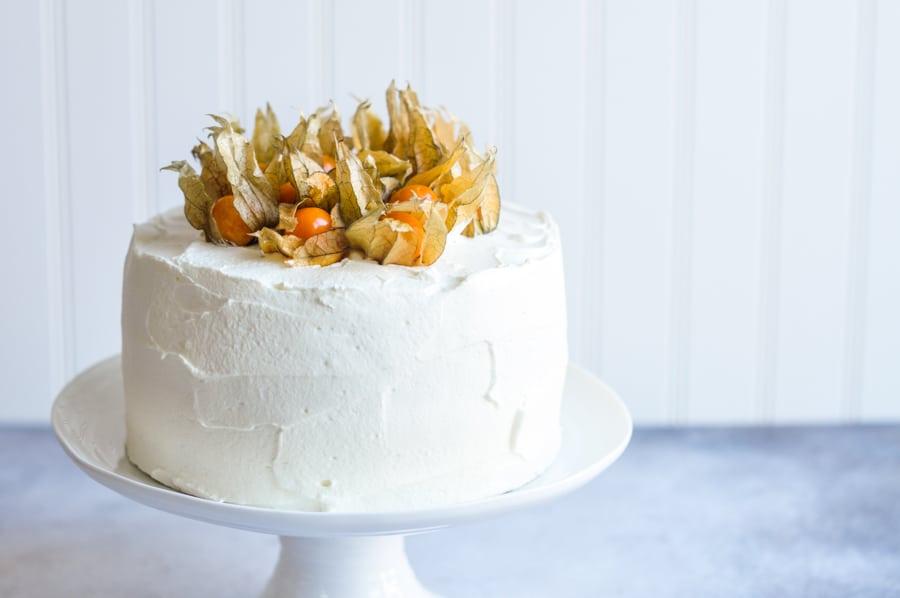 vanilla sponge cake with mascarpone frosting on cake stand
