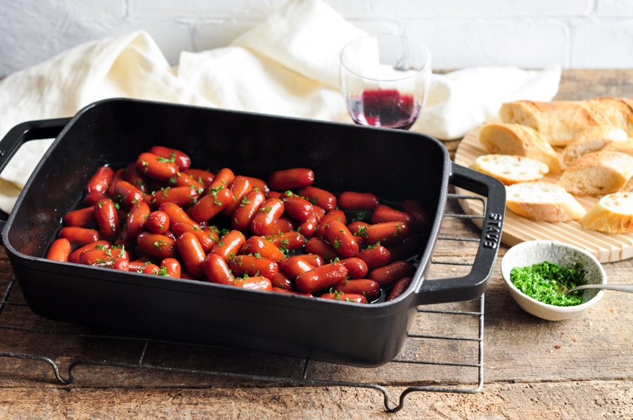 honey soy sriracha cocktail sausages in baking dish