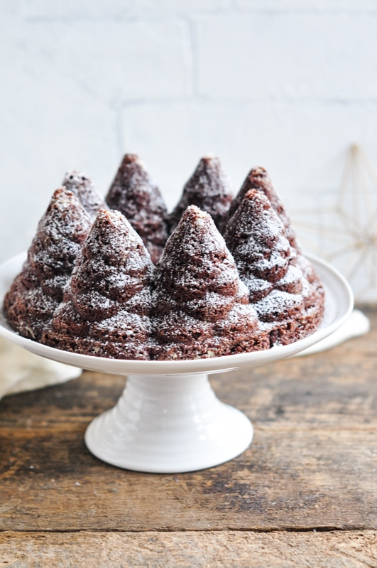 chocolate gingerbread bundt cake on white cake stand