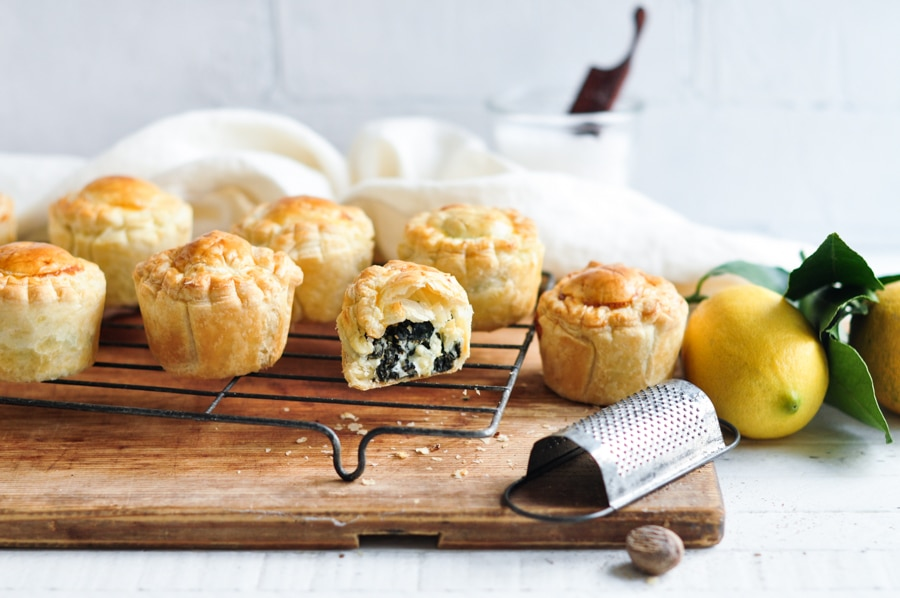 mini spinach and feta pies on wire rack