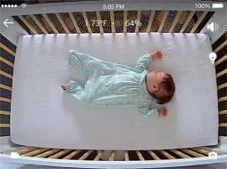 Video Image of Baby Sleeping in Crib on Back.