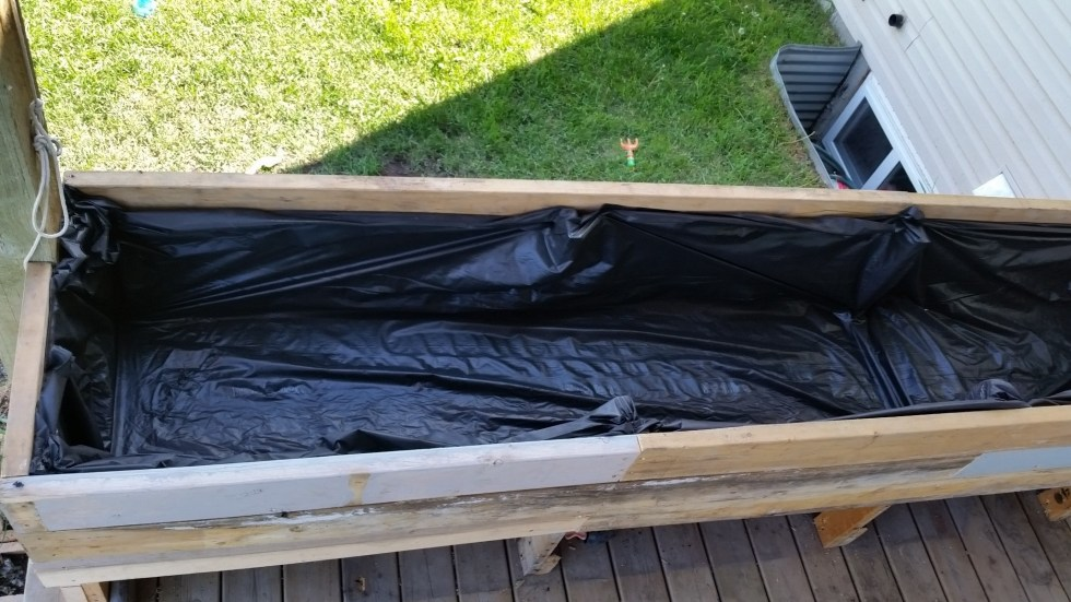liner of townhouse deck wicking bed
