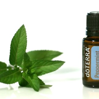 Bottle of Peppermint oil from Doterra with leaves