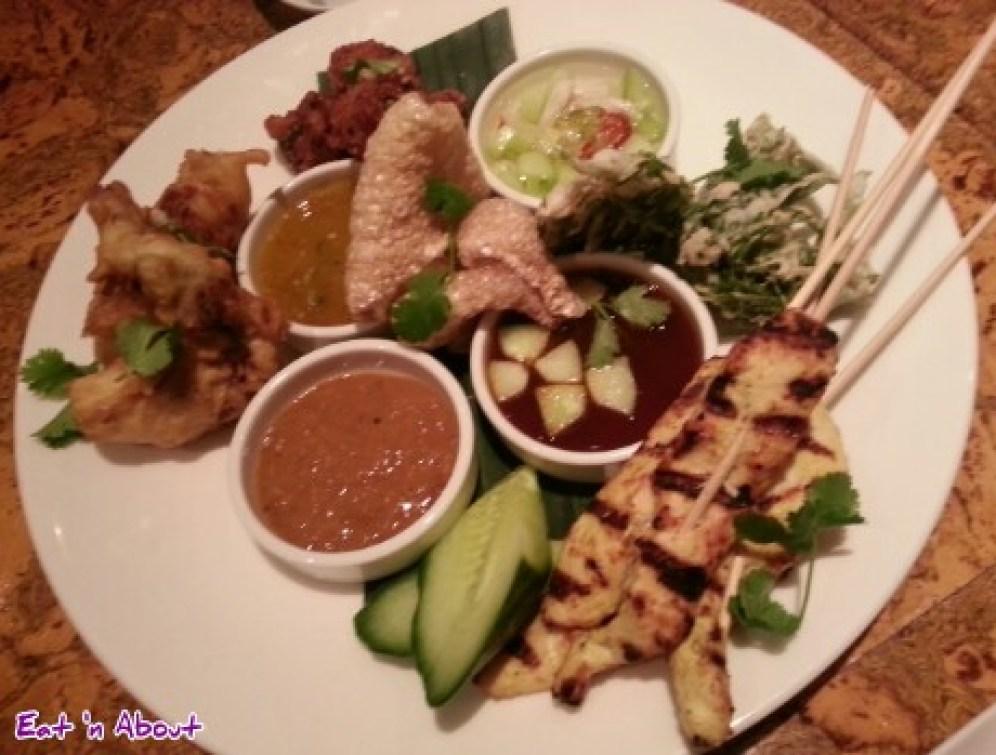 satay gai, pork rinds, tempura fern, nahm jim, and crispy fried oysters at Maenam