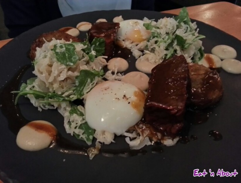Short Rib with hash brown croquettes, sous vide eggs, caramelized onion puree at the Oakwood Canadian Bistro