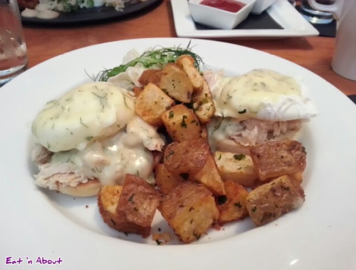 Confit Tuna Benedict with dill hollandaise, fennel salad, home fries at the Oakwood Canadian Bistro