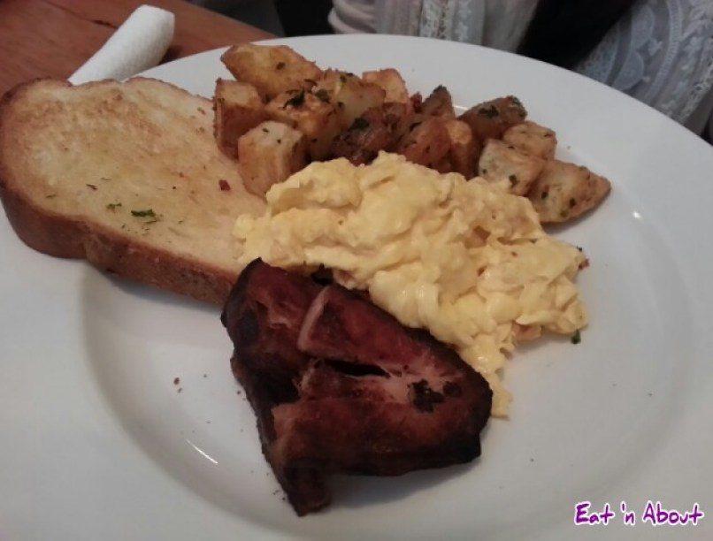 Maple Confit Pork Belly with scrambled eggs, home fries, toast at the Oakwood Canadian Bistro