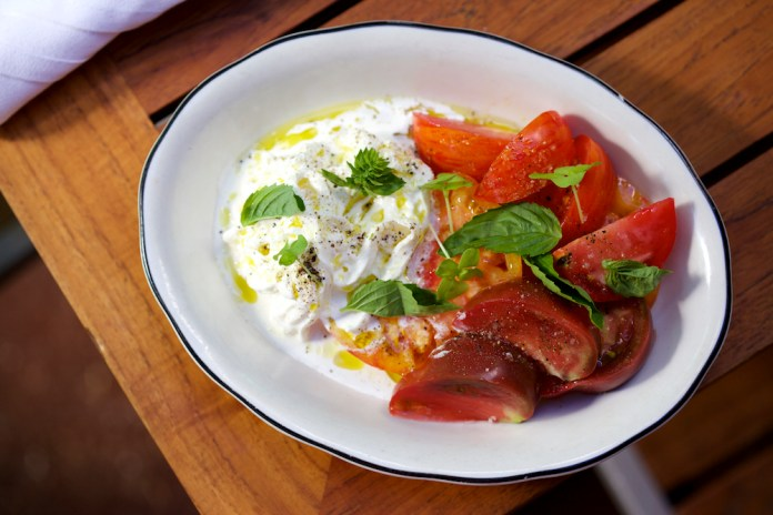 Stracciatella with heirloom tomatoes, fresh basil, extra virgin olive oil and fleur de sel