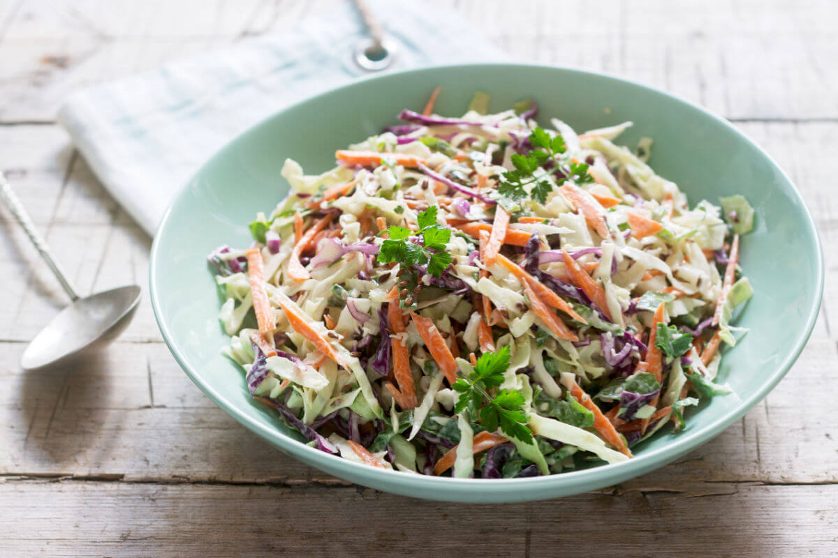 Bowl of Crunchy Asian Slaw - crunchy shredded vegetables in a salty/sweet dressing.