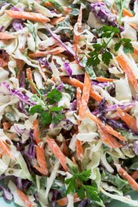 Closeup of crunchy vegetable slaw in an Asian dressing