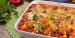 Homemade truckstop beef enchiladas in white casserole dish.