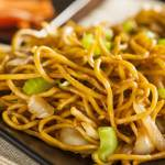 A brown plate of easy vegetable lo mein - better than take-out.