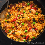 Chicken, chorizo and shrimp paella in a black pan