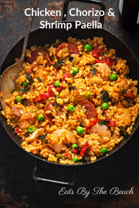 Black skillet with chicken, chorizo, and shrimp paella