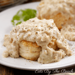 Plate of biscuits topped with creamy sausage gravy
