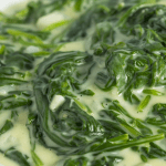 Easy side dish. A white bowl of steakhouse creamed spinach.
