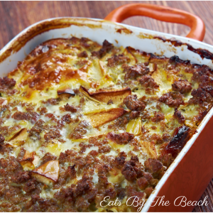 An international recipe for Bobotie. Made with ground beef, curry, raisins, and topped with an egg custard, this is the ultimate comfort food.
