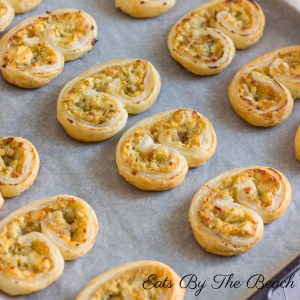 Buttery, flaky puff pastry slices with roasted garlic and parmesan cheese - makes a savory appetizer