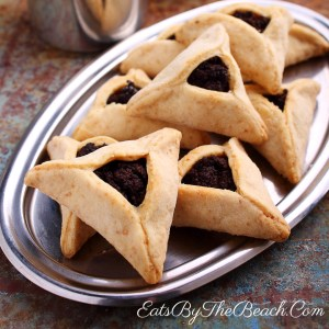 A traditional Purim cookie recipe: These poppy seed hamantaschen are delicious triangles of pastry filled with a poppy seed and date filling.
