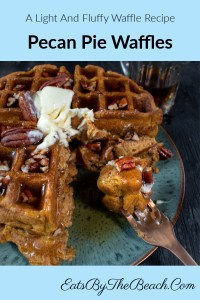 Plate with a light and fluffy waffle with chopped pecans in the batter, topped with homemade butter pecan syrup and garnished with melting butter and even more pecans. Delicious.