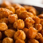 A healthy snack of spicy, crispy roasted chickpeas flavored with salt and taco seasoning.