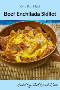 A skillet with a beef enchilada casserole - a one-pan meal made by EatsByTheBeach.Com