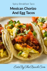 Spicy breakfast tacos with Mexican chorizo, scrambled eggs, tomatoes, and cilantro.
