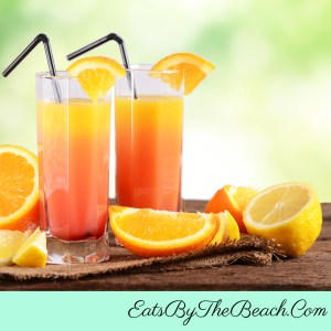 Glasses of the classic tropical cocktail-Sex On The Beach. Orange juice, cranberry juice, vodka, and peach schnapps make for a delicious cocktail that packs a punch.