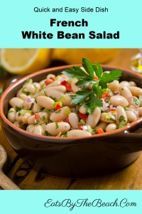 A bowl of French White Bean Salad - cannellini beans, minced aromatic vegetables in a classic red wine vinaigrette flavored with Herbs de Provence.