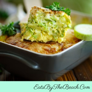 A serving of Cheesy Zucchini Casserole - shredded zucchini, eggs, sour cream, aromatics, rice, and four kinds of cheese. It's a great easy side dish, a light lunch, or a brunch dish.