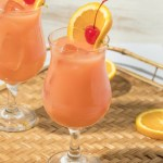 A take on a classic NOLA cocktail, this Florida Hurricane Cocktail is full of tropical flavors and two types of rum. Served in a tall hurricane glass and garnished with a slice or orange and a maraschino cherry, this tropical cocktail packs a punch.