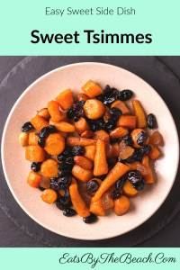 Dish of roasted carrots, sweet potatoes, dried fruits, cinnamon, rum, and orange juice. This side dish is the perfect compliment to any roasted or grilled meats.